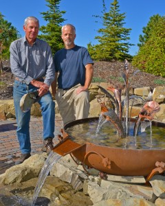 Mike Simpson, left, visionary behind the Sacred Garden; and Glen Lott, sculptor of the metal fountainhead