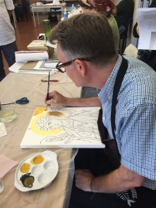 Iconographer Peter Murphy from Canterbury, England demonstrates egg tempera painting for students.