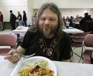 A regular patron enjoys his meal.