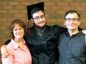 Peter with his proud parents at High School Graduation